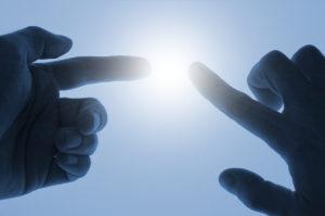 bigstock_Energy_Between_Fingers_1371749-300x199.jpg