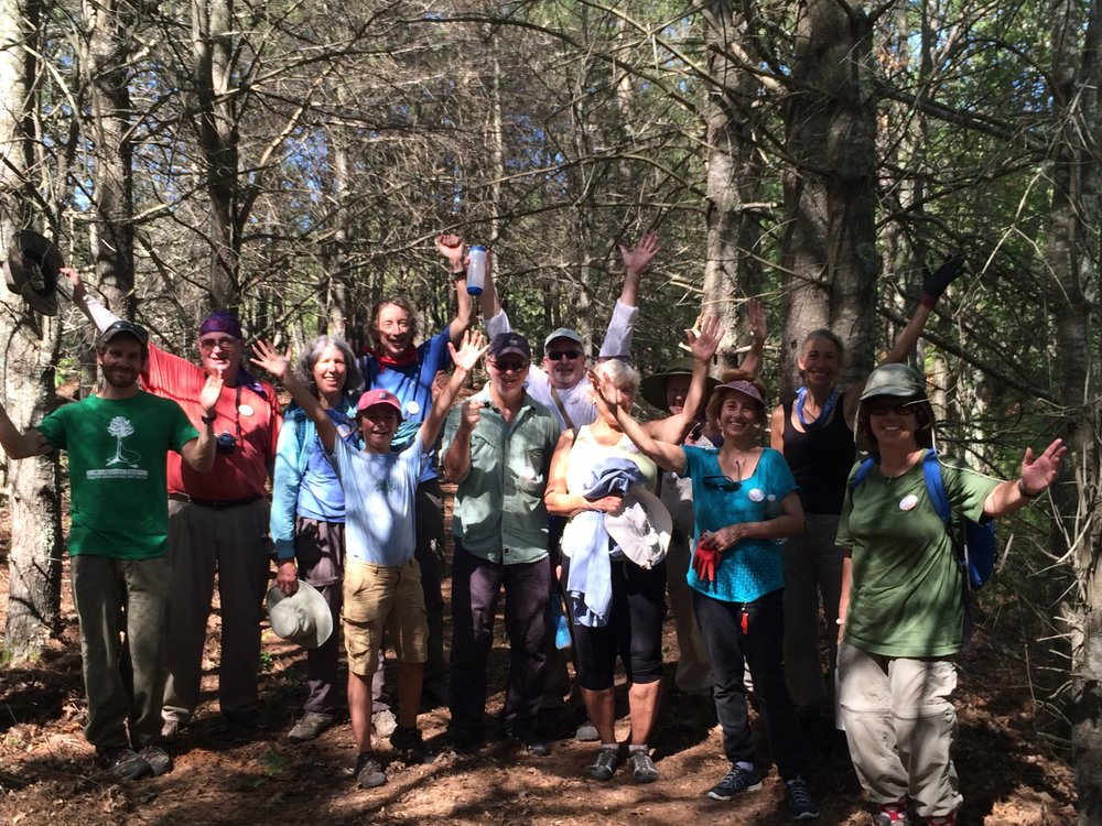 Sierra Club volunteers gather at the new trail head at Emery East Preserve