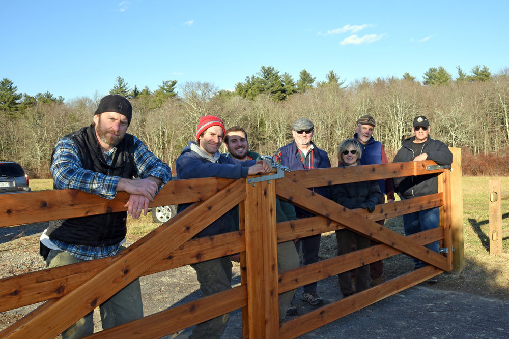 Stewardship volunteers and staff worked together to complete the new memorial gate at the entrance of Great River Preserve on Auburn St. in Bridgewater. Photo by Rob MacDonald.