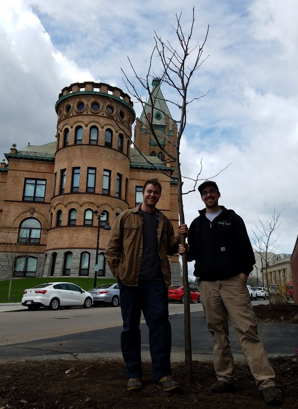 Tommy Blanchard and Conor Michaud with a recently planted tree at Brockton City Hall