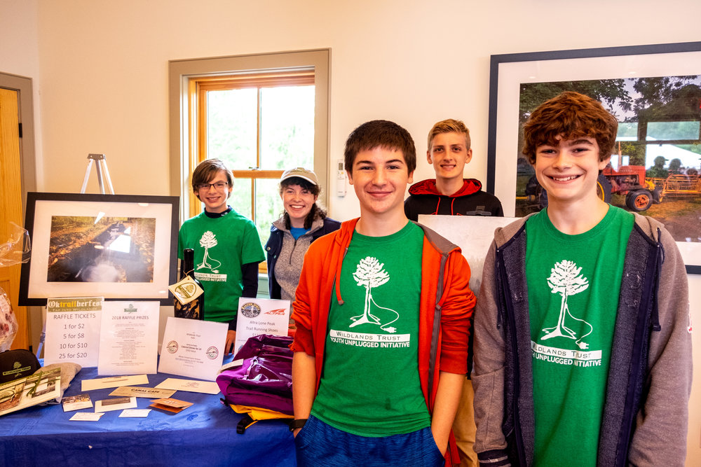 Green Team members stand next to the raffle table at OkTRAILberfest. Photo courtesy of Alex Cattullo.