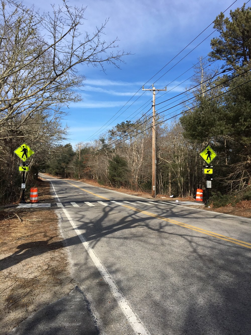 A new crosswalk across Long Pond Road features lights to alert drivers of pedestrians crossing.
