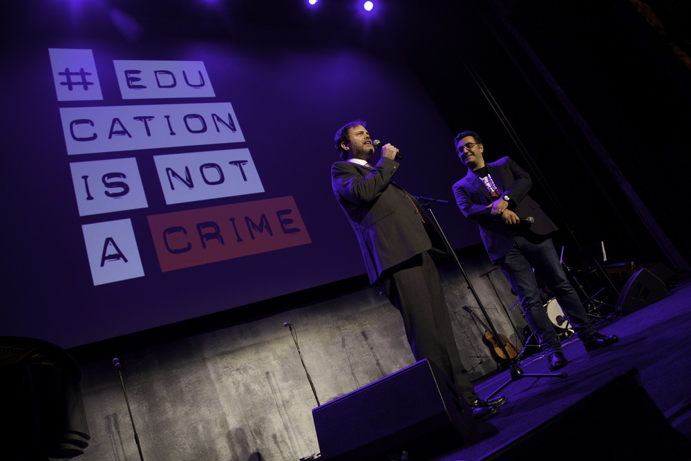 Actor Rainn Wilson with Maziar Bahari at Education is not a Crime Live in LA, February 2015.