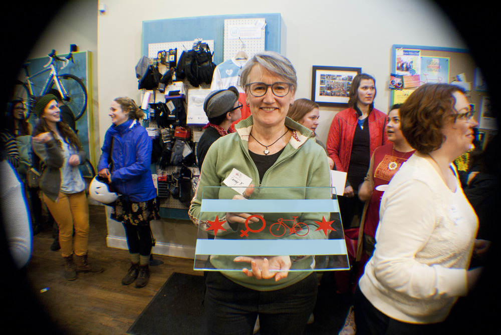 Our raffle winner of the custom Justin Haugen's Women Bike Chicago Glass art!