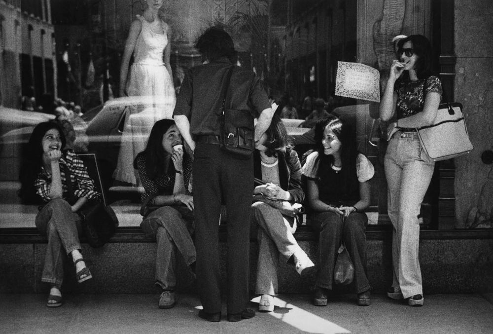 15_32_Women sitting by a store window_Dan Wynn Archive.jpg