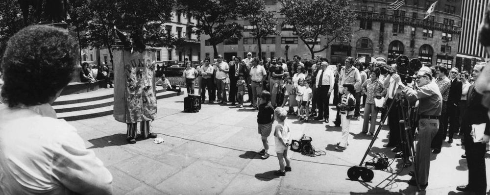 15_50_Pedestrians gathered on the street watching an act #2_Dan Wynn Archive.jpg