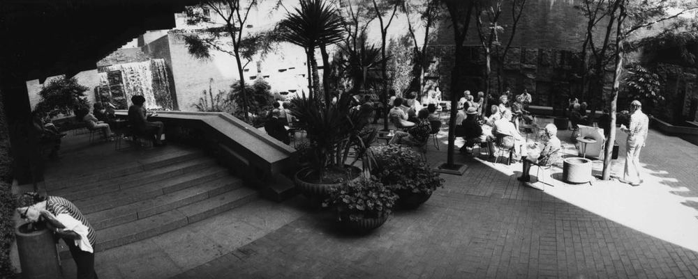 15_65_People sitting in outdoor area surrounded by trees and fountains_Dan Wynn Archive.jpg