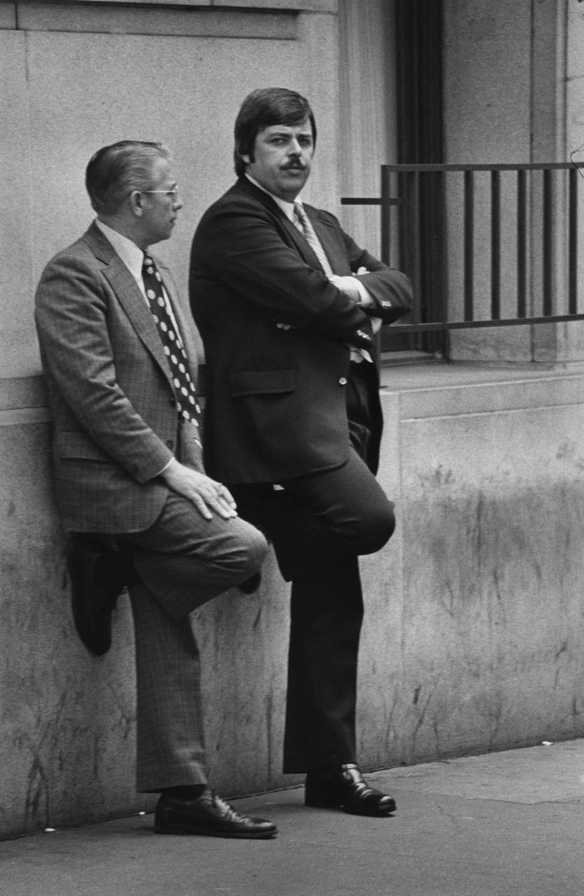 15_81_Two business men leaning against a building_Dan Wynn Archive.jpg