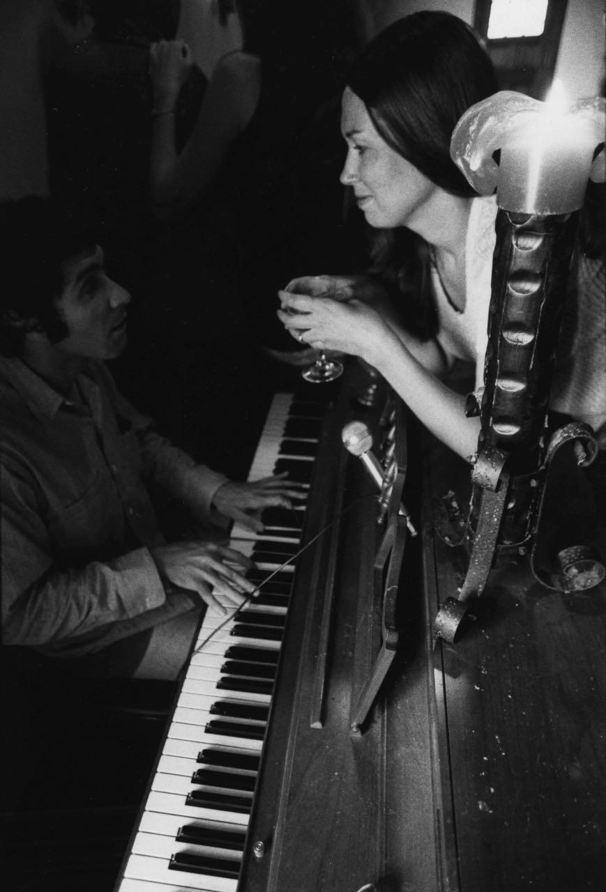 15_20_Woman talking to man over piano_Dan Wynn Archive.jpg