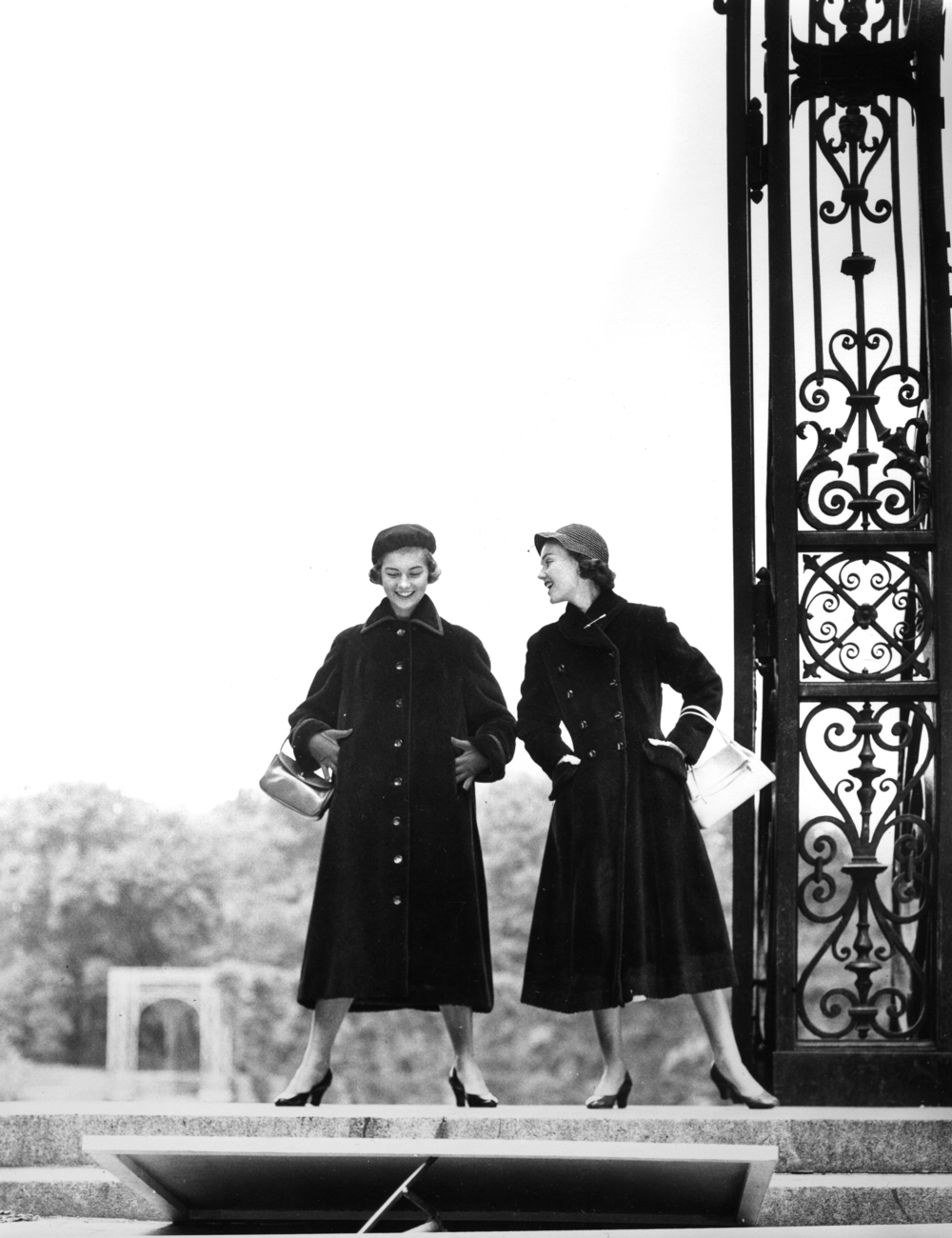 13_1_Two Woman Standing Next to a Gate_Dan Wynn Archive 2.jpeg