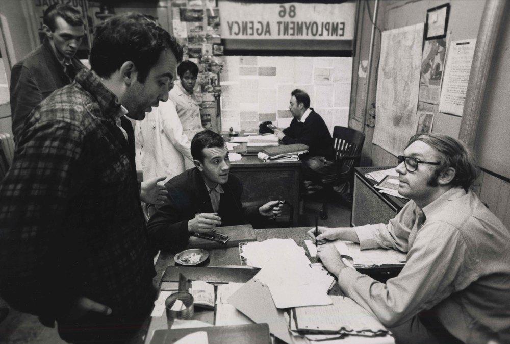 15_106_Man inside of employment agency talking to a worker_Dan Wynn Archive.jpeg