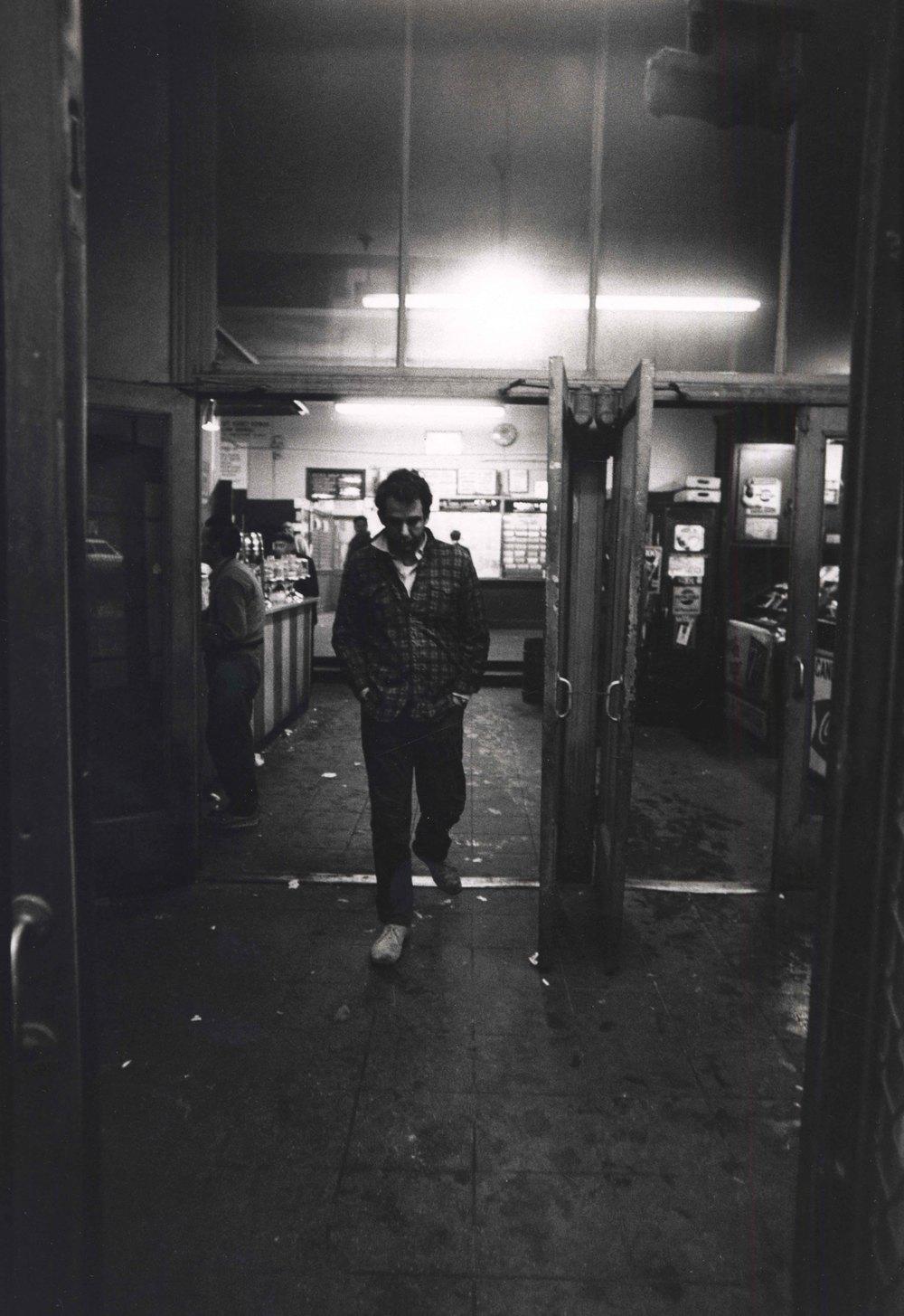 15_107_Man walking out of double doors_Dan Wynn Archive.jpeg