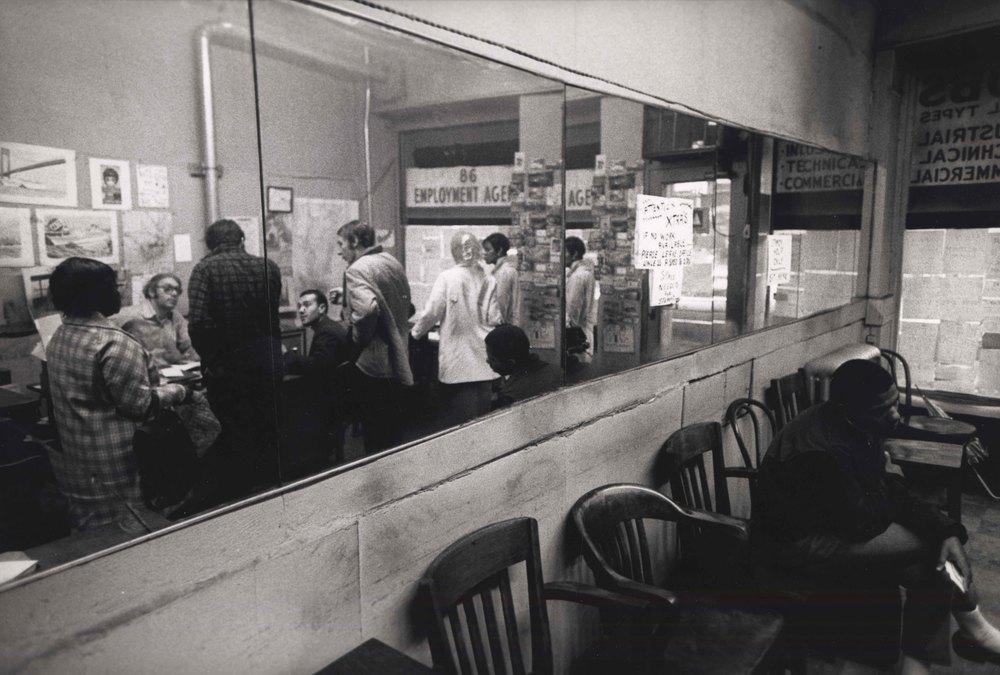 15_109_View of employment agency through a mirror _Dan Wynn Archive.jpeg
