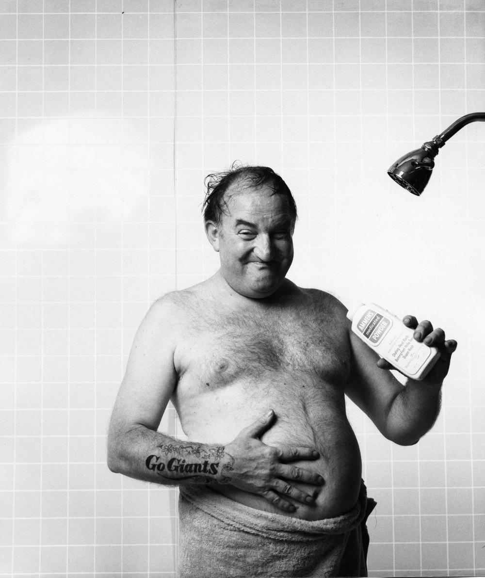 16_5_Topless man holding Ammens medicated powder_Dan Wynn Archive.jpeg