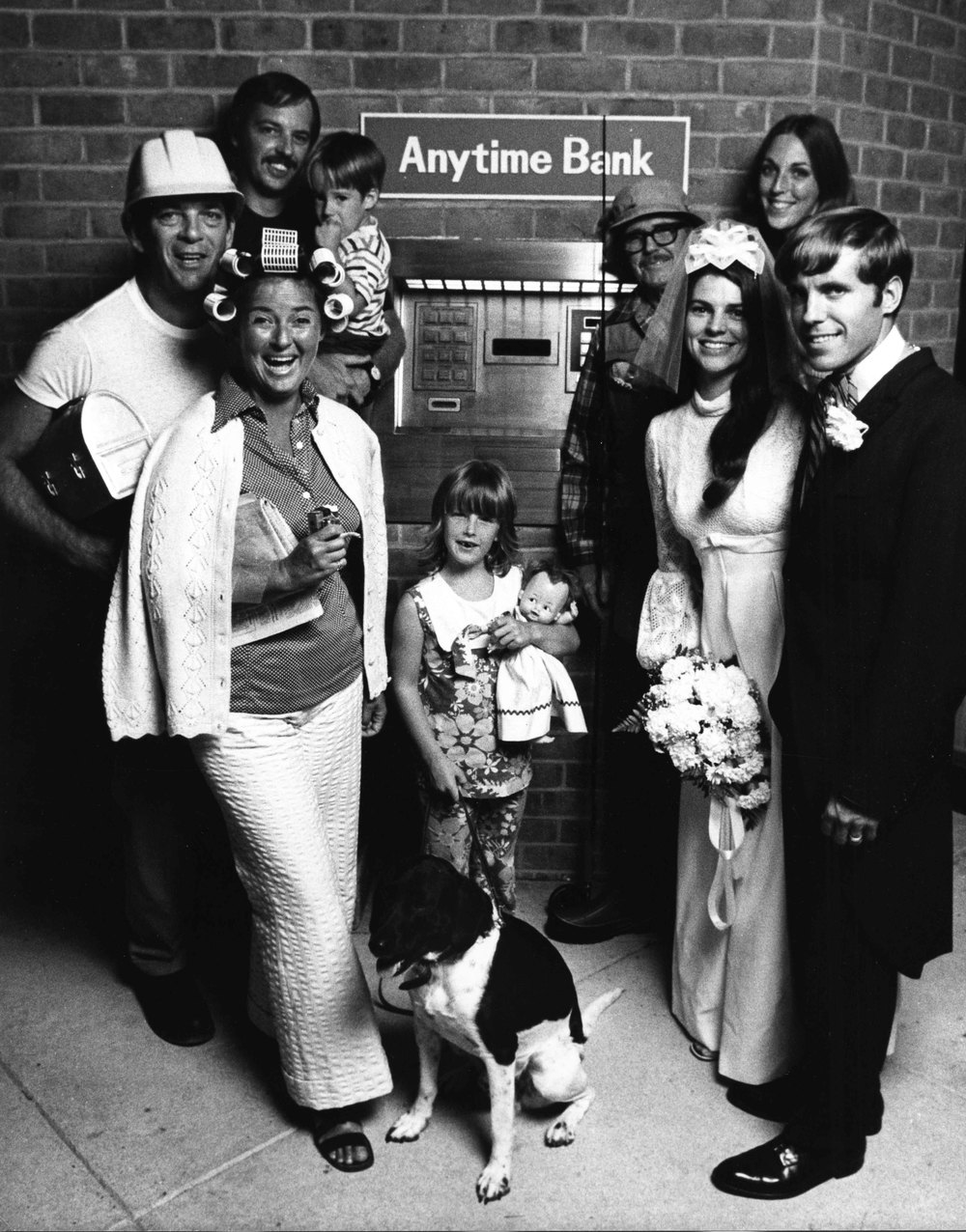 16_13_Family portrait in front of Anytime Bank #3_Dan Wynn Archive.jpeg
