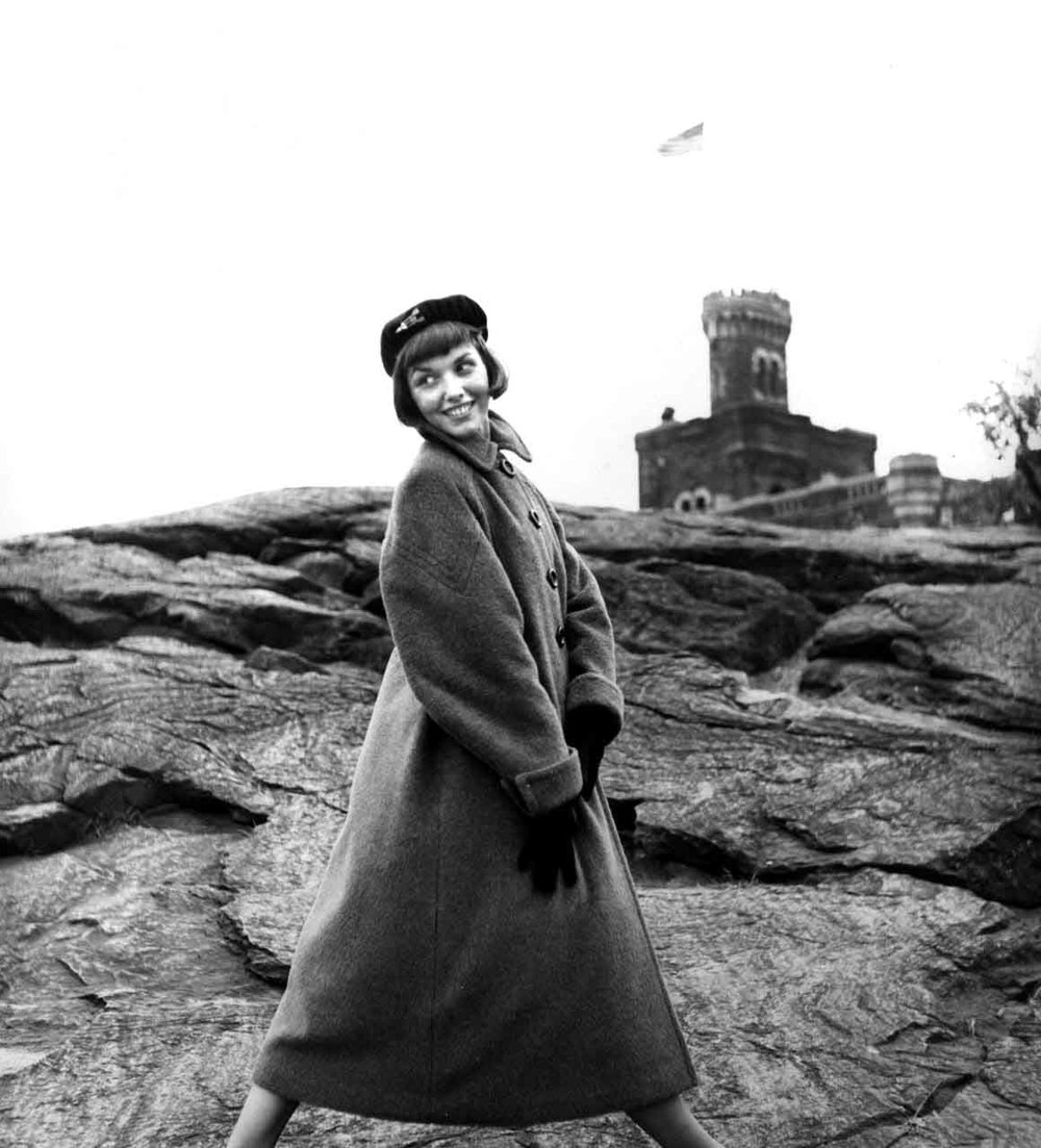 13_56_Model wearing a long coat and hat posing outdoors_Dan Wynn Archive.jpg