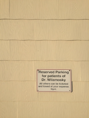 You may park at the side of the building at the reserved spots (you can use spots for patients of Dr. Wilamosky).