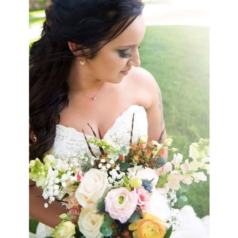 Laura Holding Flowers.jpg