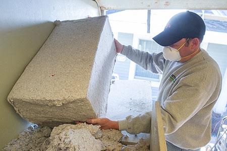 Chad loading cellulose into hopper.