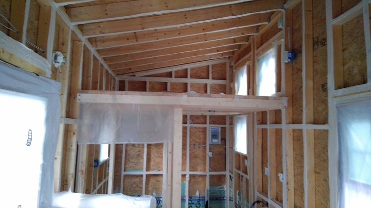 Our spray foam team prepped the tiny house. -