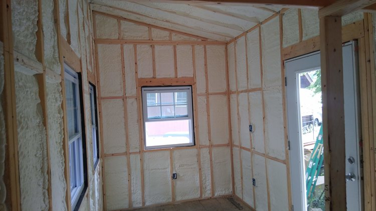 Three inches of closed-cell spray foam was applied to the walls. -