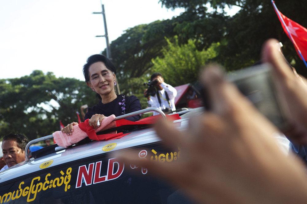 A week before Burma's historic election, NLD leader Aung San Suu Kyi arrived at a rally greeted by thousands of supporters. (Credit: Dene-Hern Chen)