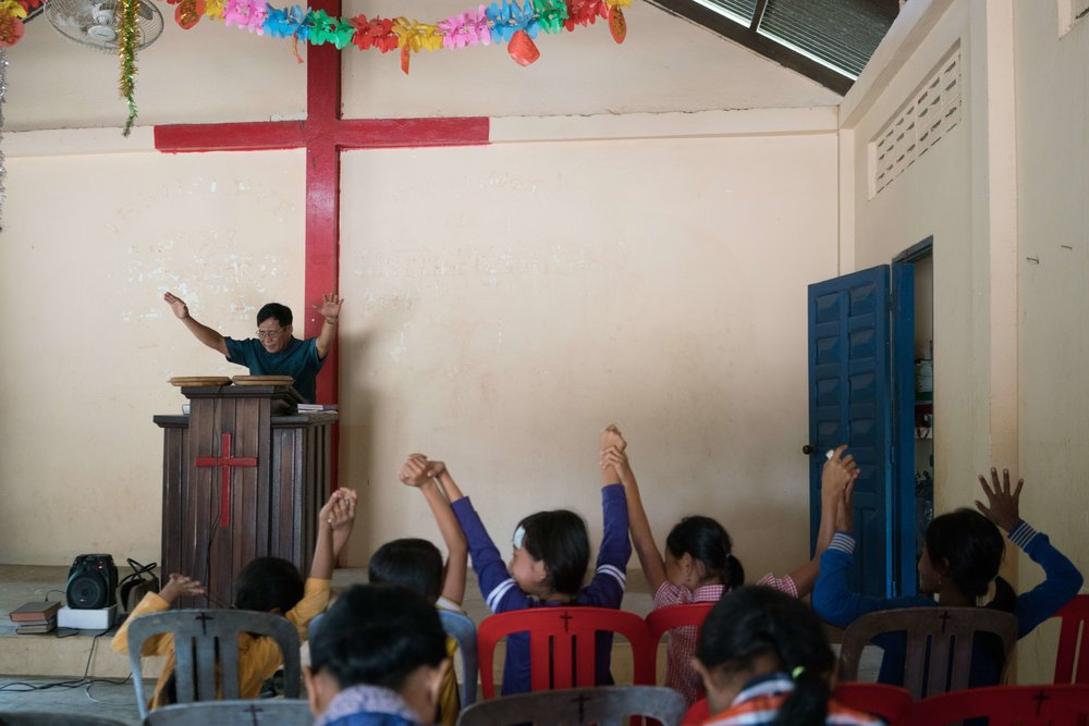 Ing Sophat, a former military commander for the Khmer Rouge, is now a Christian pastor. He addresses his congregation in his church in Kompong Speu province. (Credit: Thomas Cristofoletti