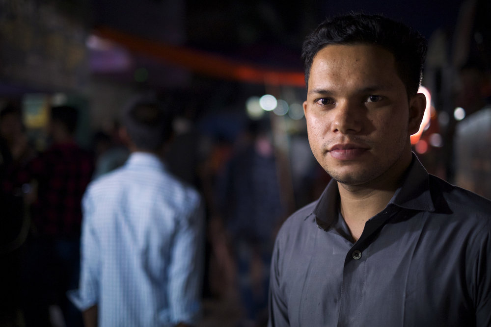 Mohammad Ayoub, 22, has moved up quickly in the ranks since he started working in his factory in April 2017, going from a helper to a supervisor. But still, he worries about revealing his true status as a Rohingya refugee, as he believes that the Bangladeshi colleagues will turn against him. (Credit: Dene-Hern Chen)