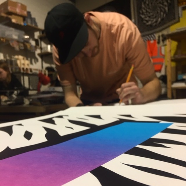 Mr Penfold signing the prints in his Bristol studio.
