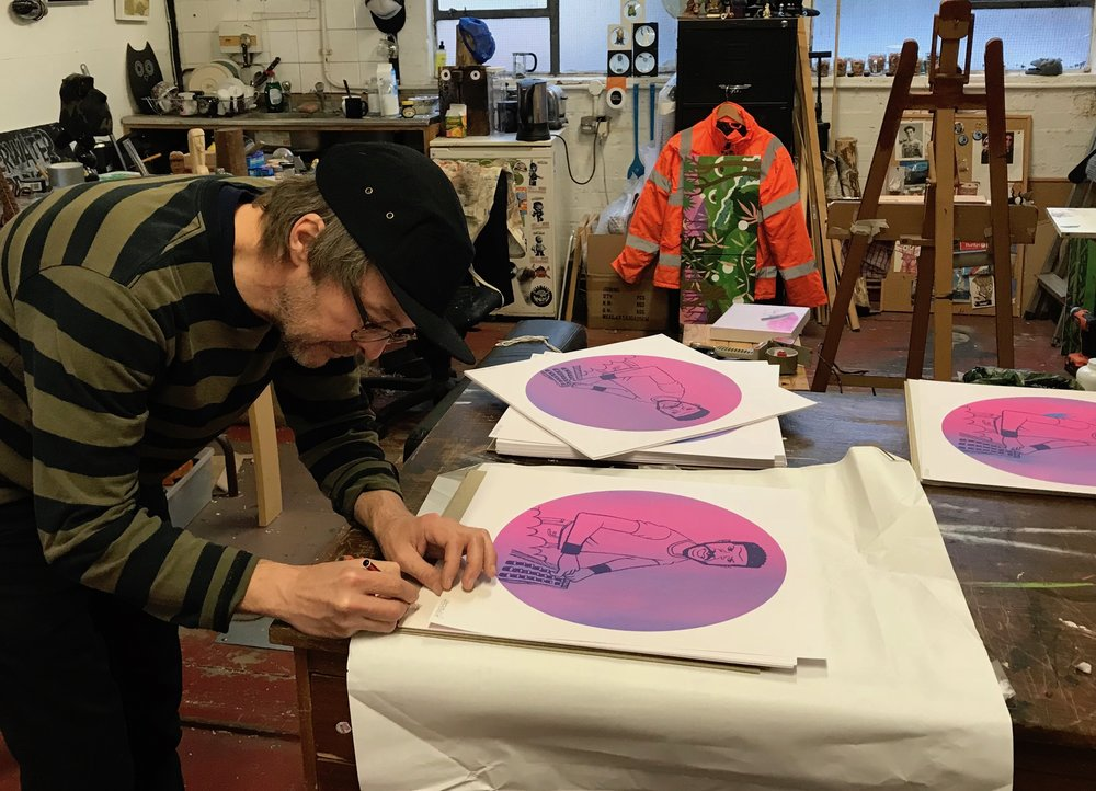Pete signing the prints in his East London studio
