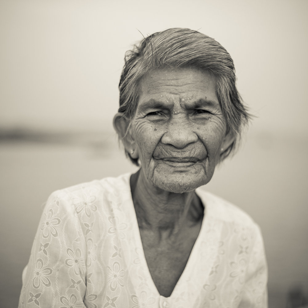 I wade through solitude to the cottage where we used to gather to drink rice wine, enjoying false peace.  I sit under the same palm-leaf roof, gaze at your chairs but see no one, hear only your laughs.          U Sam Oeur, Cambodian Poet    - Sophea Mam, from Samlout, Genocide Survivor.