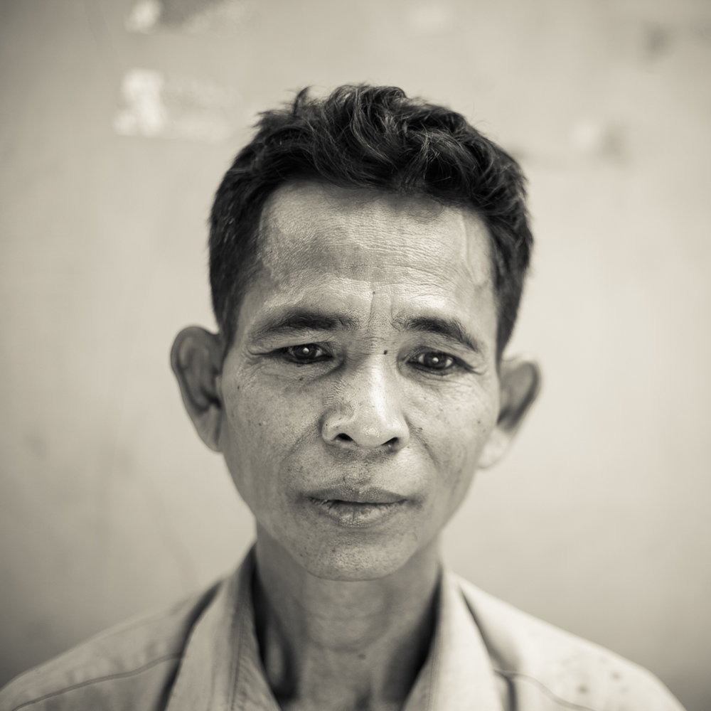 'I lost my leg doing slave work for Angkar during Democratic Kampuchea.  Angkar killed my parents, and my younger brother and sisters died of famine and poisoning. I am haunted by their spirits, because they are not at peace. The gohsts wander around my dreams, I cannot sleep, a cannot close my eyes. I was 12 years old.  Today I am being fitted for a prosthetic leg for the first time. I am grateful because now I will be able to work in the field, and I can mean something in my village.' - Chhoen Phan, 46,  from O'toteung Village, Siem Reap, Child Slave