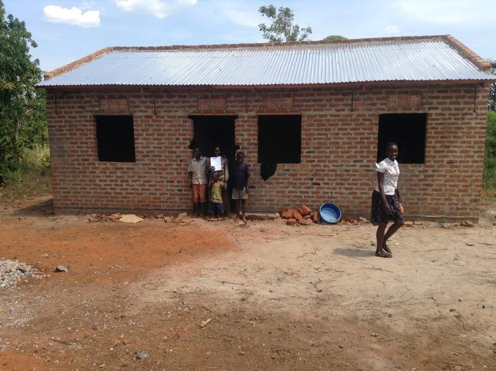 14 Patricia Namulansi finished home & latrine (doors & shutters not hung yet) IMG_0095.jpg