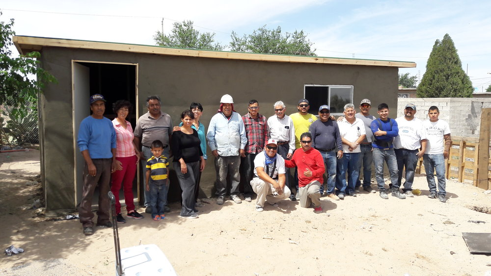 """Jorge and Bertha as so grateful for their new home! Bertha has been fighting cancer and had recently been very discouraged by the pain of her disease. She and Jorge had paid for their land but couldn't construct a home because of the medical expenses that were mounting. Now, thanks to the funds from the golf tournament, they have a beautiful stucco home. Their message to you is: """"Thank you to God for giving us the help and supprt that we need most, a place to call home."""""""