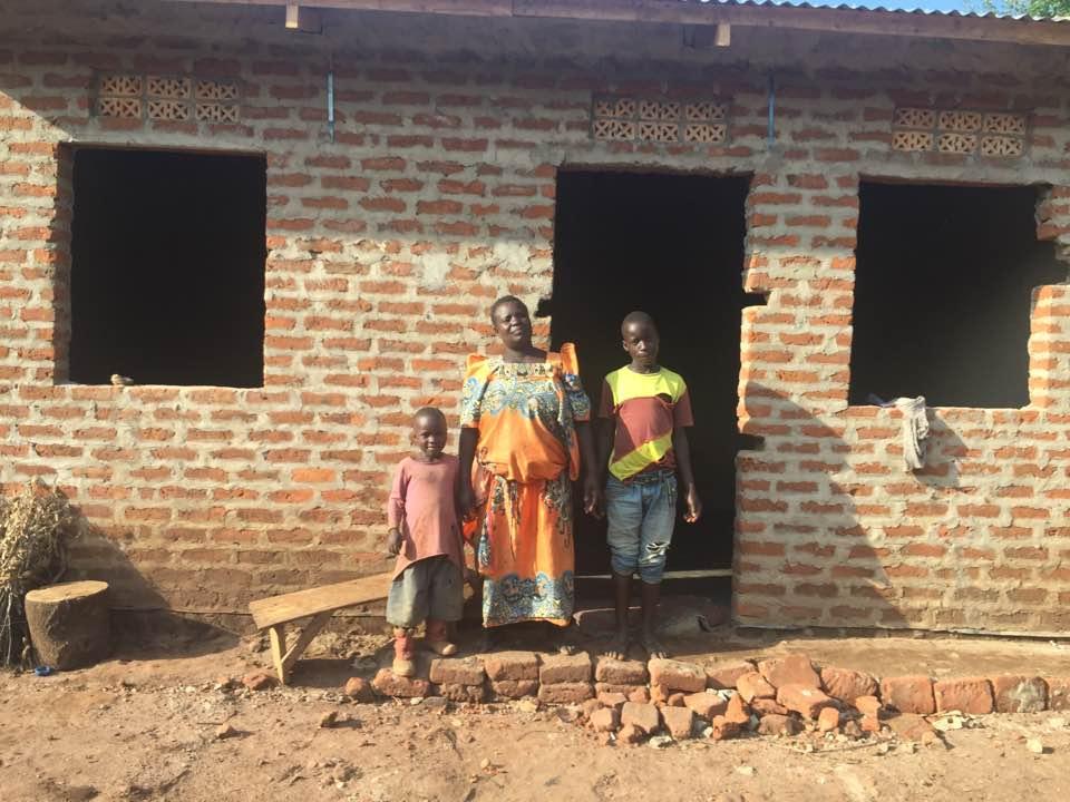 13- Zabinah Namwebya has 3 grandchildren in front of nearly finished home .jpg