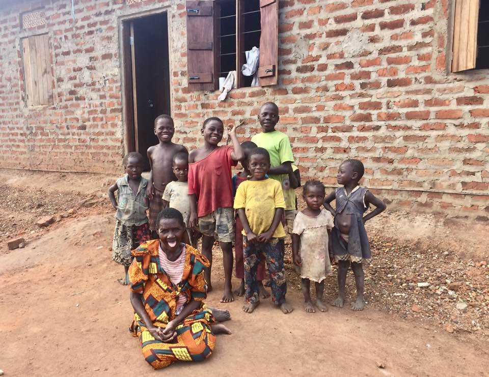 2-Aidah Kafuko 2018 in front of new home with her 5 grandchildren plus some neighbor children .jpg