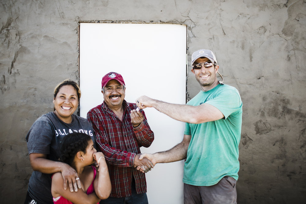 I would love to tell you about Father's Day 2018 because it's a day I want to always remember. That weekend my family was a part of the Homes for Homes team traveling to Tijuana, Mexico to construct two homes. The first family receiving a home that weekend was the Valeria Rocha family. Jose Luis and Aide worked alongside the construction crew to help build their home, and they were full of personality.  Aide was a resourceful mom, and she even talked the workers into putting  all  the extra concrete on a wall behind her home so every bit of material was put to its best use!  It was great watching them work with each other and interact with us while their house was built.  And then, having the opportunity to give Jose Luis the keys to his family's home was just incredible to experience. Their joy and excitement couldn't be contained, and neither could mine.  What a gift!  Josh Terry, Board Member