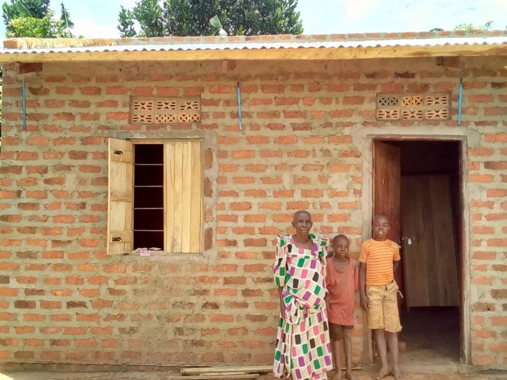 Jessica is a widow living in Nasuti, Uganda. Her son, Mark died three years ago, leaving two children for her to raise. The home shewas living in constantly leaked.  But now, thanks to your generosity, this family has a brand new brick home! We're so grateful for your support of the mission of Homes for Homes and for the tremendous hope that's been given to this precious family.