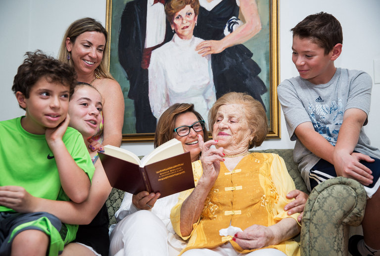 "Kitty (holding book), narrator Sonia Erlich, and Sonia's family gather for a photoshoot for  The New York Times  article, ""Have a Story to Tell? Your Personal Memoirist Is Here"", published August 31, 2016"