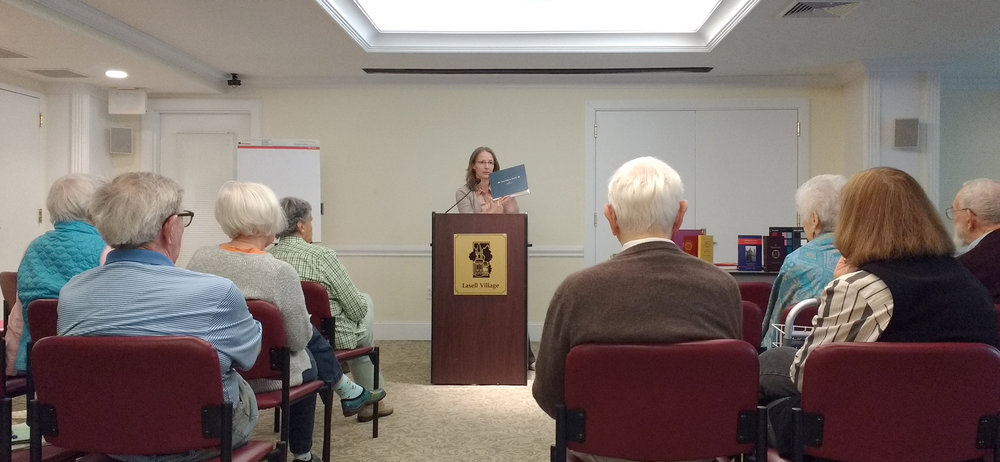 Ali delivers a presentation on the process and importance of memoir writing at Lasell Village, 2016