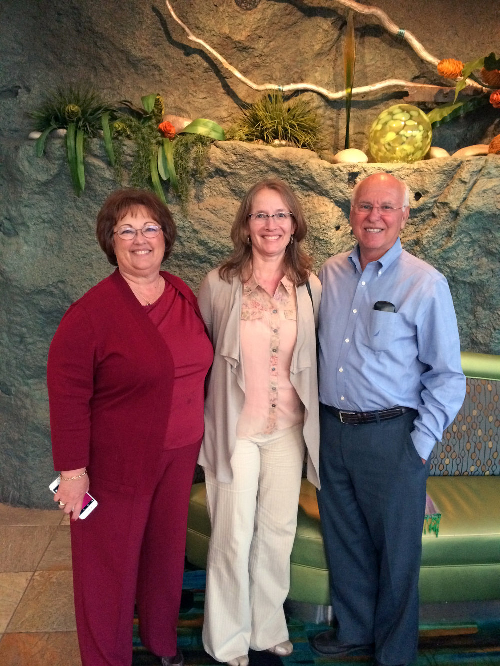 Ali (center) visits wonderful former client Joyce Phillips and her husband, Gary, in San Diego. We helped Joyce produce three beautiful family history books.