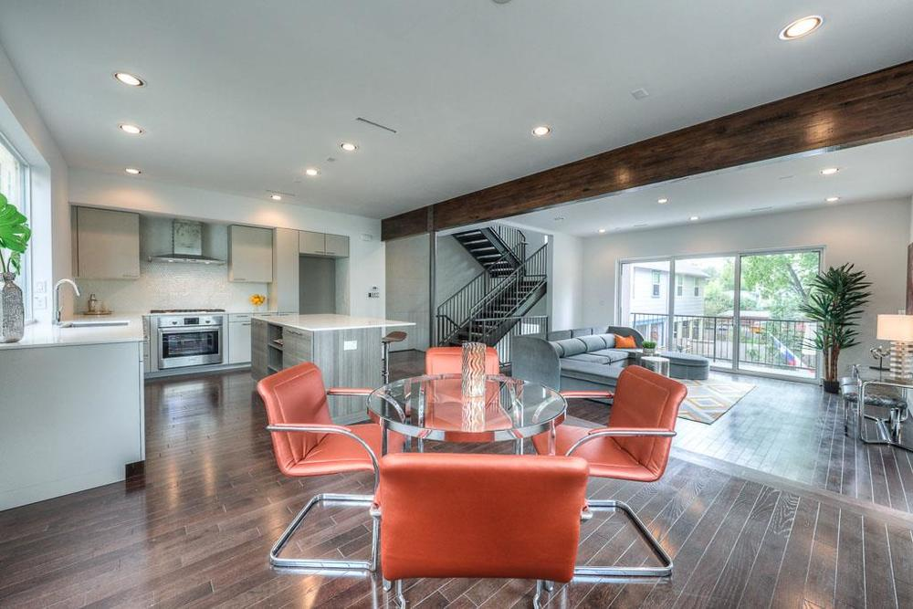 Modern appointments in this open living space with balcony access.