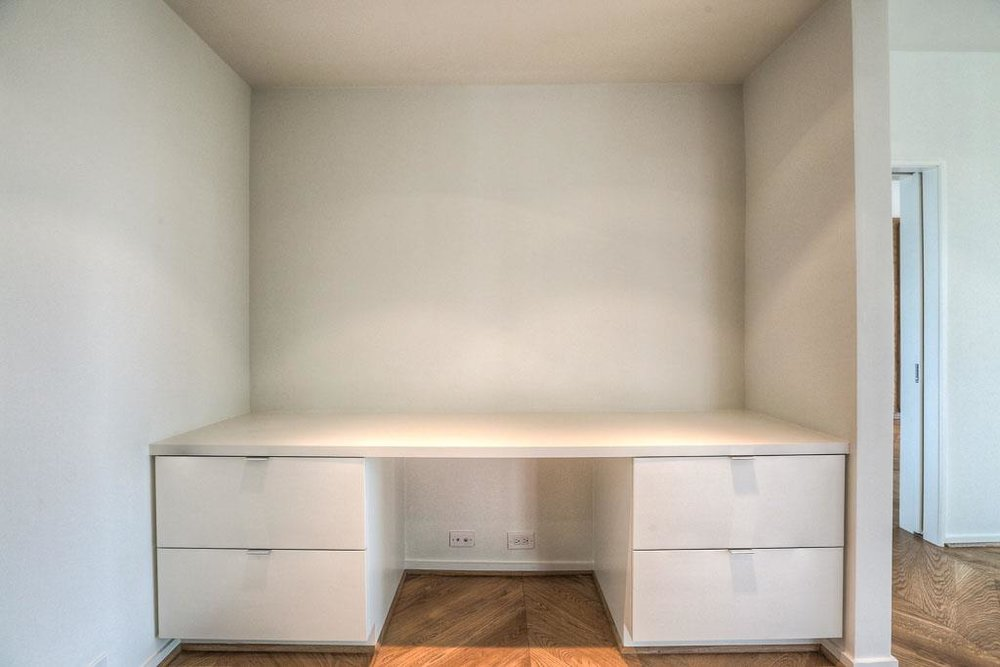 Custom cabinets for an office area or extra closet.