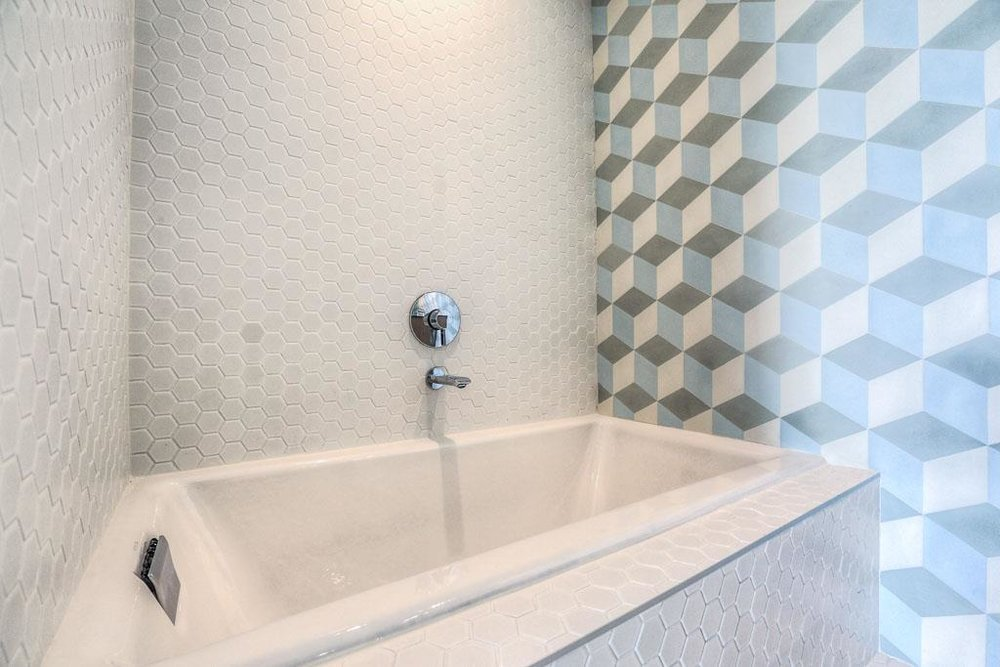 Separate shower and tub in this gorgeous bathroom.