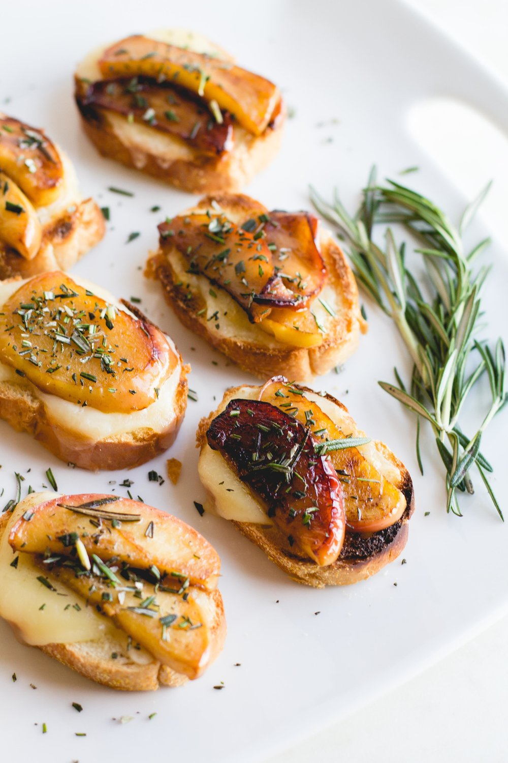 Crostini with Caramelized Apples, Fontina + Rosemary
