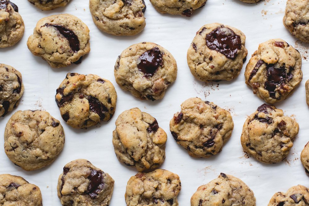 Bacon + Dark Chocolate Cookies - These cookies are sweet and salty, soft with a slight crunch, buttery, and rich. They're so amazingly addictive! Get the recipe at sarahjhauser.com! | Sarah J. Hauser #chocolate #chocolatechipcookies #bacon #sweets #cookies #baking