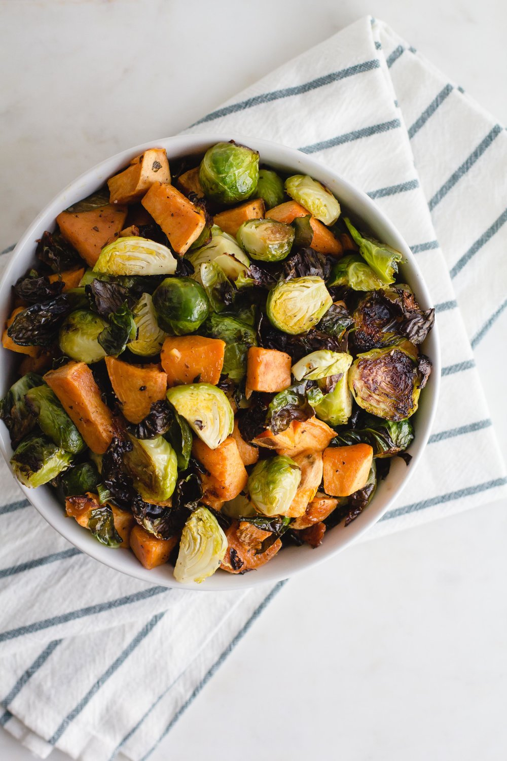 Maple Roasted Sweet Potatoes + Brussels Sprouts | Sarah J. Hauser #sides #dinner #paleo #easyweeknight