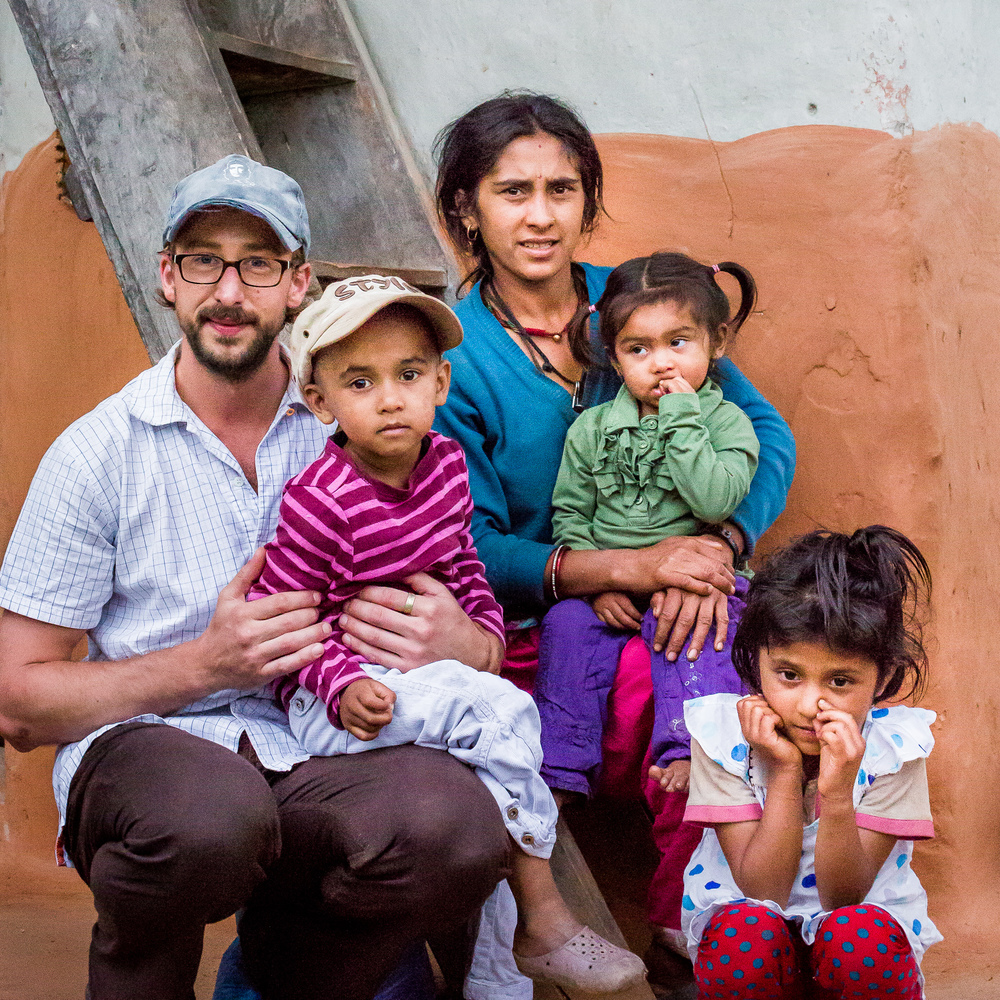 Me with a poor family from Necha. The family is wearing clothing donated by Dutch people and distributed by Micro-Care Nepal Foundation.