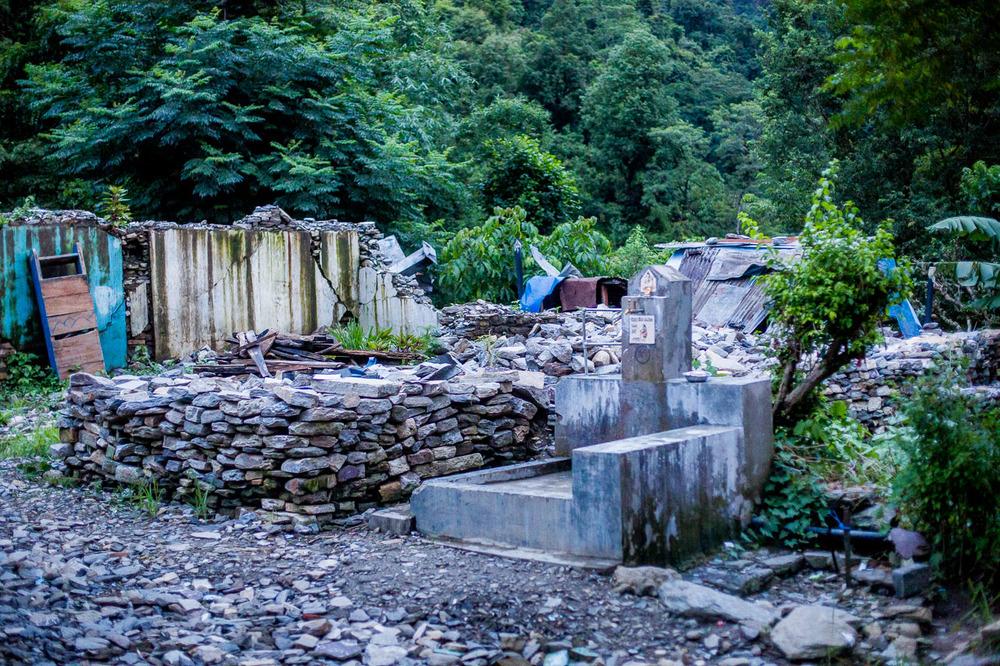 Water tap in the destroyed bazaar (market).