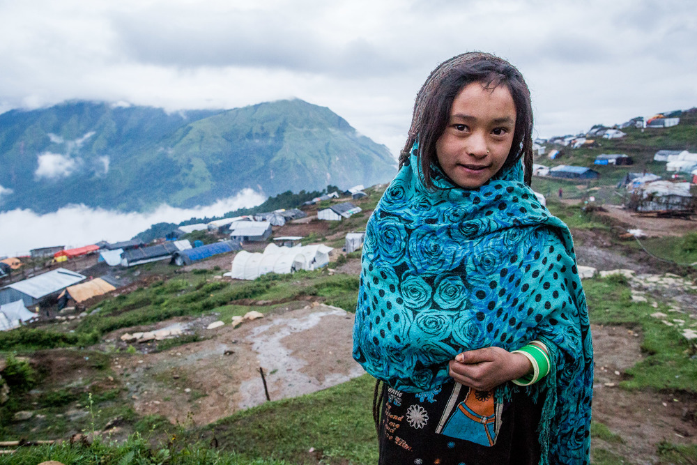 Child close to her plastic house on the top of the hill where ''new' Laprak is situated.